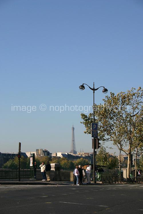 Bridge on River Seine with Eiffel Tower in background, Paris, France<br />