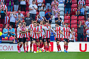 Chris Maguire (#7) of Sunderland AFC celebrates with team mates after scoring the second goal for Sunderland during the EFL Sky Bet League 1 match between Sunderland and AFC Wimbledon at the Stadium Of Light, Sunderland, England on 24 August 2019.