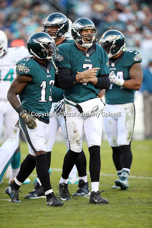 Philadelphia Eagles wide receiver Josh Huff (13) helps Philadelphia Eagles quarterback Sam Bradford (7) while Bradford yells out in pain after an injury on the play during the 2015 week 10 regular season NFL football game against the Miami Dolphins on Sunday, Nov. 15, 2015 in Philadelphia. The Dolphins won the game 20-19. (©Paul Anthony Spinelli)