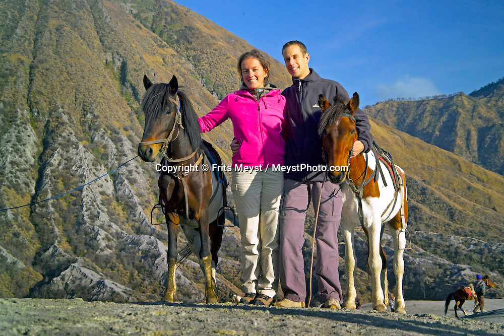 Bromo, Java, Indonesia, October 2006. Two Dutch tourists on horseback at the Bromo Volcano. The island of Java is rich with culture, colorful friendly people, dutch colonial history and beautiful landscapes. Photo by Frits Meyst/Adventure4ever.com