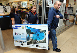 © Licensed to London News Pictures. 28/11/2014<br /> This family with their new TV from Currys/PC world in Bluewater,Kent.<br />  Black Friday shoppers at Bluewater in Kent today (28.11.2014)<br /> (Byline:Grant Falvey/LNP)