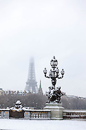 France. Paris under the snow.. Alexandre III 3 and the Eiffel Tower / Pont Alexandre III et la tour Eiffel , Paris sous la neige en hiver