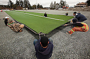Arnold Lim/News staff<br /> Installers and laborers install artificial field turf onto the new field at former Glen Lake elementary school site. Colwood, B.C. March 11, 2010.