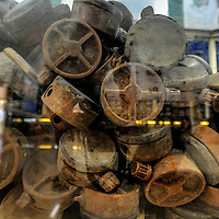Cambodia has been dealing with the insurmountable task leftover from decades of war and its legacy, unexploded ordnance or UXOs. Estimates range from 3 to 9 million unexploded bombs that are still just beneath the surface throughout the region. These bombs are left over from air strikes, artillery fire, mortar shells, rockets, grenades, anti-personnel and anti-vehicle land mines are indiscriminate weapons and do not expire, often killing or injuring between 100 to 200 people in Cambodia a year. With little resource, the countries' people and Non Governmental Organizations (NGOs) are still facing over a hundred years being exposed to this deadly issue while walking and cultivating their land in fear.<br /> <br /> Cambodian Mine Action Centre (CMAC) land mine and unexploded ordnance display at the CMAC headquarters in the province of Kampong Thom, Cambodia. Jan. 2013.