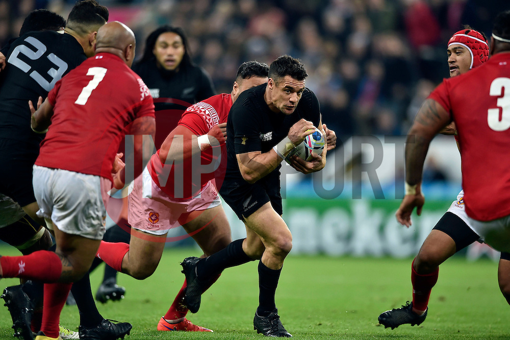 Dan Carter of New Zealand takes on the Tonga defence - Mandatory byline: Patrick Khachfe/JMP - 07966 386802 - 09/10/2015 - RUGBY UNION - St James' Park - Newcastle, England - New Zealand v Tonga - Rugby World Cup 2015 Pool C.