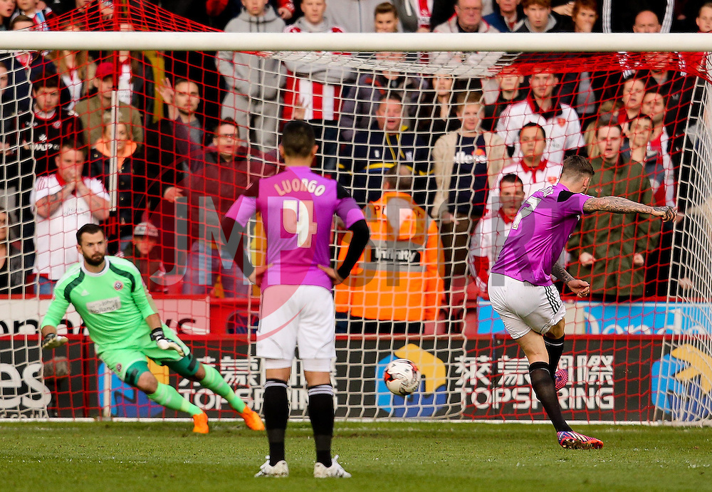 Ben Gladwin of Swindon Town has a first half penalty saved by Mark Howard of Sheffield United  - Photo mandatory by-line: Matt McNulty/JMP - Mobile: 07966 386802 - 07/05/2015 - SPORT - Football - Sheffield - Bramall Lane - Sheffield United v Swindon Town - Sky Bet League One