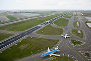Nederland, Noord-Holland, Haarlemmermeer, 16-04-2008; Schiphol, Zwanenburgbaan, vliegtuigen van KLM en Martinair klaar voor de start, taxien naar startbaan; taxiebaan, landingsbaan, asfalt, ..luchtfoto (toeslag); aerial photo (additional fee required); .foto Siebe Swart / photo Siebe Swart