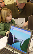 As her father Kip looks on, Callie Main, 4, from Beavercreek designs a bridge using software at the American Society of Civil Engineers (ASCE) booth.  After the design is finished Callie is able test the design to see if it works.