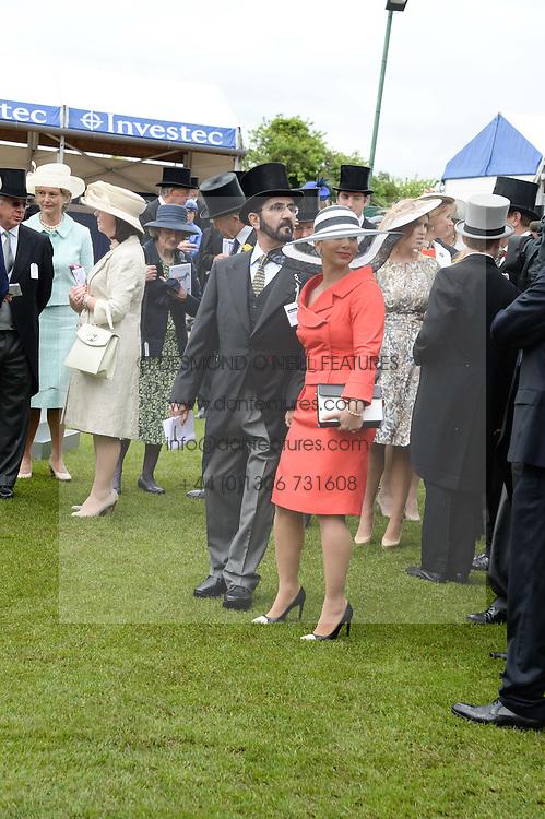 Sheikh Mohammed bin Rashid al Maktoum and his wife Princess Haya of Jordan at the Investec Derby 2013 held at Epsom Racecourse, Epsom, Surrey on 1st June 2013.