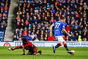 Scott Arfield of Rangers evades the challenge from Aaron Tshibola of Kilmarnock during the Ladbrokes Scottish Premiership match between Rangers and Kilmarnock at Ibrox, Glasgow, Scotland on 31 October 2018.