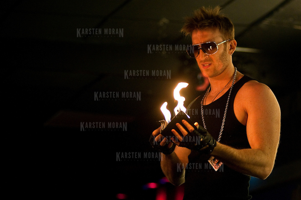 March 2, 2011 - Manhattan, NY : Illusionist Elliot Zimet performs at the Times Square Arts Center in midtown on March 2. Elliot's wallet bursts into flames.