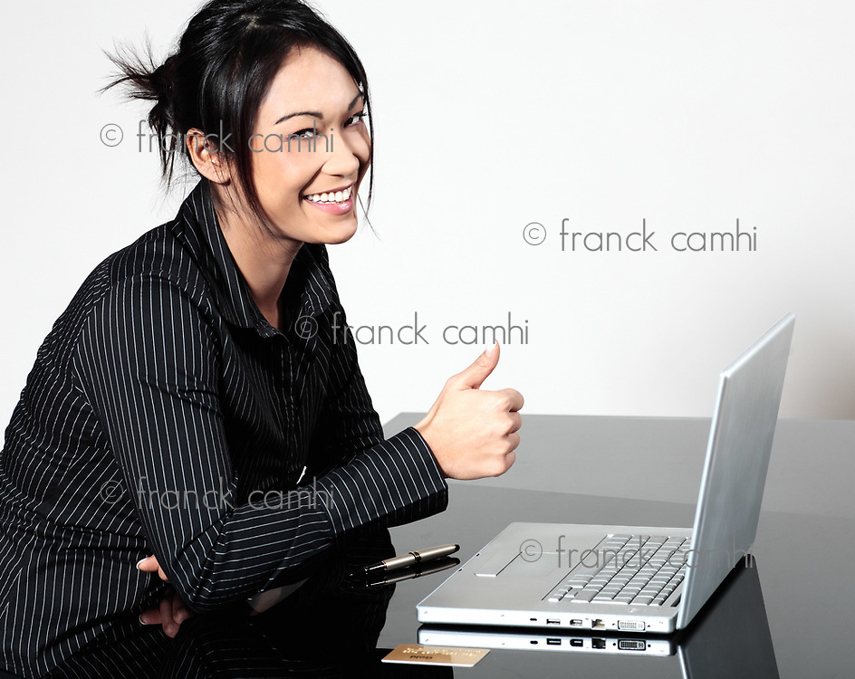 cute funny young expressive women asian working woman happy with laptop