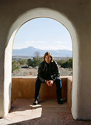 man seated in an archway in New Mexico