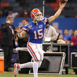 Jan 01, 2010; New Orleans, LA, USA; Florida Gators quarterback Tim Tebow (15) during warm ups prior to kickoff against the Cincinnati Bearcats for the 2010 Sugar Bowl at the Louisiana Superdome.  Mandatory Credit: Derick E. Hingle-US PRESSWIRE..