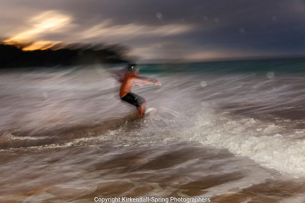 HI00411-00...HAWAI'I - Kaleo Carpio skim boarding at Hapuna Beach State Recreation Area on the island of Hawai'i. (MR# C14)