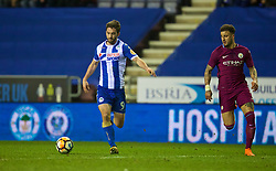 WIGAN, ENGLAND - Monday, February 19, 2018: Wigan Athletic's Will Grigg scores the winning goal to seal a 1-0 victory during the FA Cup 5th Round match between Wigan Athletic FC and Manchester City FC at the DW Stadium. (Pic by David Rawcliffe/Propaganda)