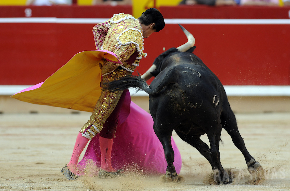Spanish matador Francisco Marco performs a pass with capote to a Cebada Gago bull during the third corrida of the San Fermin Festival, on July 9, 2012,  in the Northern Spanish city of Pamplona. PHOTO / Rafa Rivas