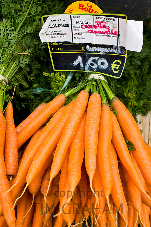 Local produce carrots on sale at farmers market in Normandy, France
