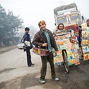 Few vendors near truck parking in Punjab.