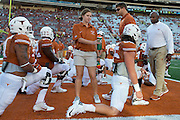 AUSTIN, TX - AUGUST 30:  Texas Longhorns head coach Charlie Strong walks with his team during warmups before kickoff against the North Texas Mean Green on August 30, 2014 at Darrell K Royal-Texas Memorial Stadium in Austin, Texas.  (Photo by Cooper Neill/Getty Images) *** Local Caption *** Charlie Strong
