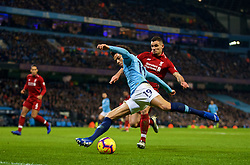 MANCHESTER, ENGLAND - Thursday, January 3, 2019: Manchester City's Leroy Sane and Liverpool's Dejan Lovren during the FA Premier League match between Manchester City FC and Liverpool FC at the Etihad Stadium. (Pic by David Rawcliffe/Propaganda)