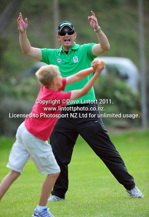 NCC coach Shane Bond celebrates a catch. NCC cricket supercamp at Anderson Park, Wellington, New Zealand on Thursday, 13 January 2011. Photo: Dave Lintott / photosport.co.nz