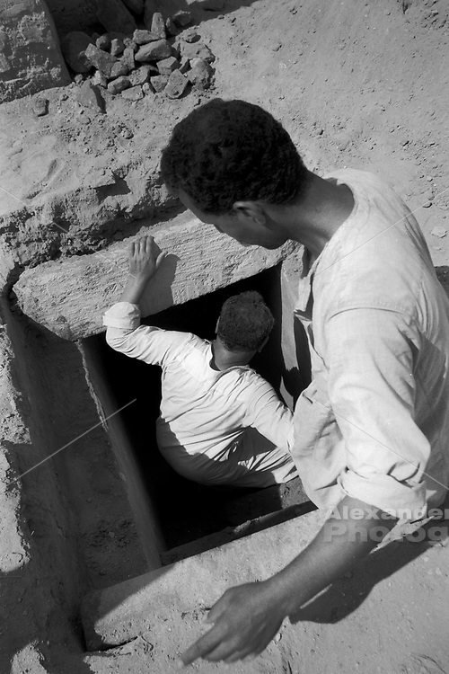 Cairo, Egypt, The City of the Dead, 2000 - Undertakers enter a tomb crypt they have just opened.