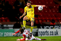 Stuart Sinclair of Bristol Rovers takes on Alfie May of Doncaster Rovers - Mandatory by-line: Robbie Stephenson/JMP - 26/03/2019 - FOOTBALL - Keepmoat Stadium - Doncaster, England - Doncaster Rovers v Bristol Rovers - Sky Bet League One