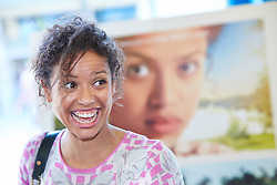 © Licensed to London News Pictures.  14/06/2014. WITNEY, UK. Actress Gugu Mbatha-Raw pictured in front of a Belle movie poster, in which she features. She returned to her home town of Witney in Oxfordshire for a special screening of the film Belle where she plays the lead role. Photo credit: Cliff Hide/LNP