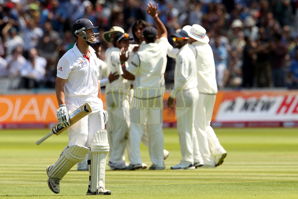 Jonathan Trott departs as India celebrate his wicket during day 4 of the first test between England and India (The 100th test match between the two countries and the 2000th test match in the history of cricket) held at Lords Cricket ground in London on the 24th July 2011...Photo by Ron Gaunt/SPORTZPICS/BCCI