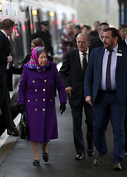 Britain's Queen Elizabeth II and The Duke of Edinburgh arrive at Kings Lynn Railway station as they arrive in Norfolk for their Christmas break on the Sandringham Estate in Norfolk.