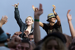 © licensed to London News Pictures . 30/06/2012 . Manchester , UK . Fans in the crowd during a performance by Beady Eye , warming up for the Stone Roses , who are on their comeback tour . Photo credit : Joel Goodman/LNP
