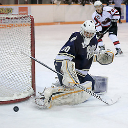 PICKERING, ON - Jan 31 : Ontario Junior Hockey League Game Action between the Pickering Panthers Hockey Club, and Toronto Lakeshore Patriots Hockey Club, Jeremy Helvig #30 of the Toronto Lakeshore Patriots Hockey Club makes the save<br /> (Photo by Keith White / OJHL Images)