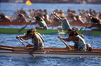 French Polynesia, Islands in the South Pacific, part of the French overseas Territories..Tahiti..Photo by Owen Franken.women in a traditional canoe race, Tahiti..Photo by Owen Franken