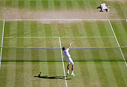 LONDON, ENGLAND - Friday, July 4, 2014: Novak Djokovic (SRB) has an easy smash as Grigor Dimitrov (BUL) lies prone during the Gentlemen's Singles Semi-Final match on day eleven of the Wimbledon Lawn Tennis Championships at the All England Lawn Tennis and Croquet Club. (Pic by David Rawcliffe/Propaganda)