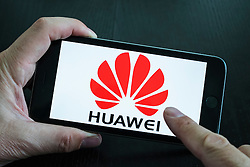 Huawei Chinese electronics company website logo showing on iPhone 6 Plus smart phone