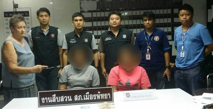Pickpockets of Australian Caught  Ladyboy Gang Member Escapes<br /> <br /> At 5pm, on the afternoon of September 27, Pattaya police arrested Ms Usa Aiemsa-ard, (35) and Ms Malinee Sae-Tang (27) and charged them with theft. A motorbike involved with the crime has been impounded.<br /> <br /> Earlier in the day sixty-nine year old Australian tourist reported that she had been robbed on a baht bus of 5,500 baht and a  bank card. At the end of her journey she noticed her purse had been taken from her bag.<br /> <br /> Officers identified the suspects from CCTV images and traced them to Thepprasit Soi 7 where they were arrested. They have both admitted the crime.<br /> <br /> A third member of the gang, a ladyboy called Mr Pom, escaped and is now being hunted.<br /> <br /> They used to identify a victim which one of them would rob, and pass the cash to another who would immediately get off the bus and onto the motorbike driven by the third.<br /> <br /> Apparently they took it in turns.<br /> <br /> The gang would then meet up later to share the spoils.<br /> <br /> They have been charged with theft.Pictured with Australian <br /> ©Exclusivepix Media