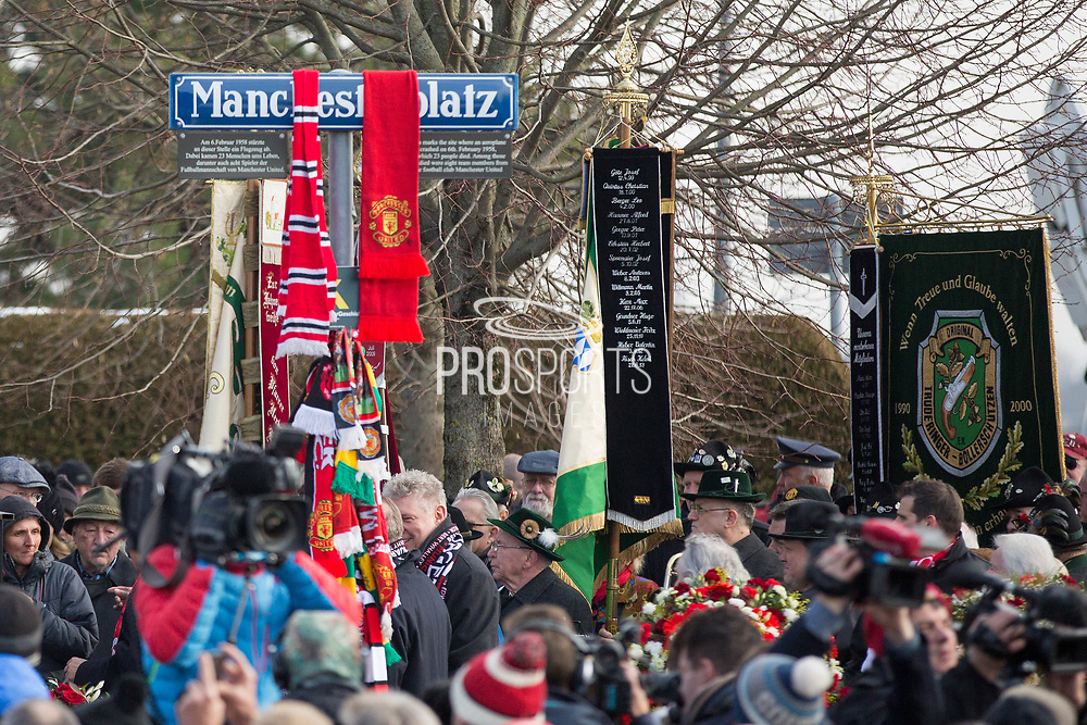 Street sign with Manchester United scarves during the ceremony at Manchesterplatz, Munich, Germany. Picture by Phil Duncan.