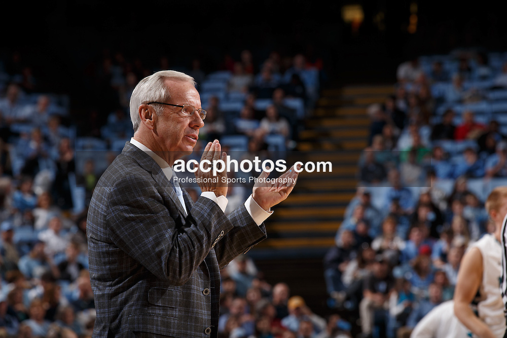 CHAPEL HILL, NC - DECEMBER 31: Head coach Roy Williams of the North Carolina Tar Heels coaches against the UNC Wilmington Seahawks on December 31, 2013 at the Dean E. Smith Center in Chapel Hill, North Carolina. North Carolina defeated UNC Wilmington 84-51. (Photo by Peyton Williams/UNC/Getty Images) *** Local Caption *** Roy Williams