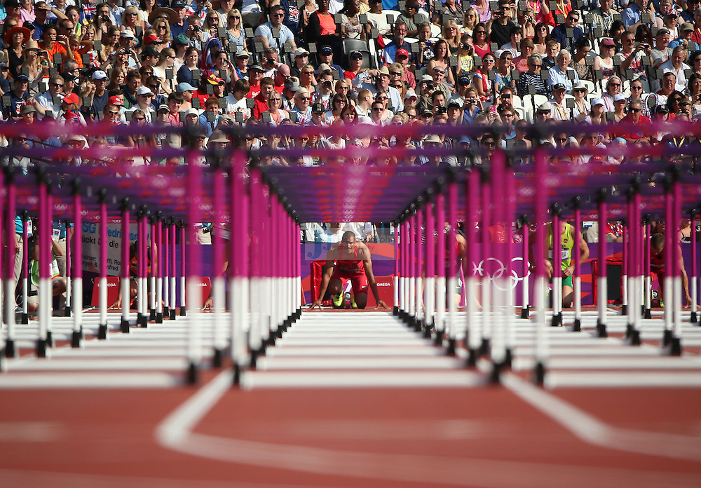 Ashton Eaton of the USA competes in the 110m hurdle portion of the decathlon during track and field at the Olympic Stadium during day 13 of the London Olympic Games in London, England, United Kingdom on August 9, 2012..(Jed Jacobsohn/for The New York Times)..