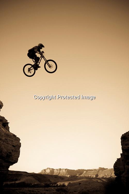 Lance Canfield jumps across the Grafton Mesa road gap near Springdale, Utah.