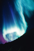Alaska. Eerie glow of Northern Lights (Aurora Borealis).