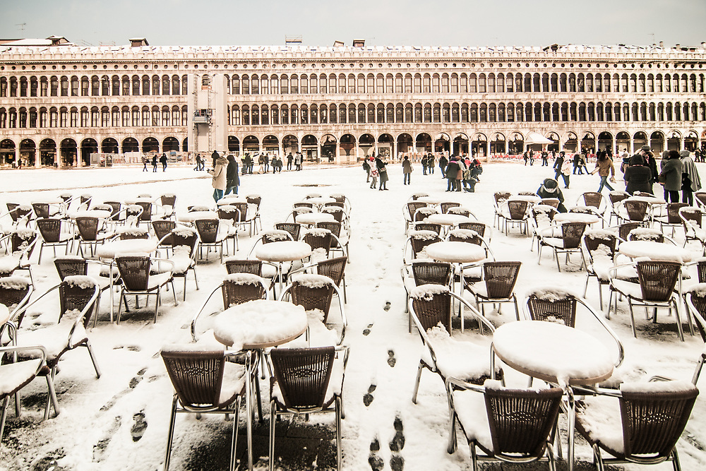 VENICE, ITALY - 28th FEBRUARY/01st MARCH 2018<br /> Snow-covered tables and chairs on St. Mark Square in Venice, Italy. A blast of freezing weather called the &ldquo;Beast from the East&rdquo; has gripped most of Europe in the middle of winter of 2018, and in Venice A snowfall has covered the city with white, making it fascinating and poetic for citizen and tourists.   &copy; Simone Padovani / Awakening