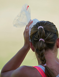 LONDON, ENGLAND - Tuesday, June 29, 2010: Ana Bogdan (ROU) uses an ice pack on her head during the Girls' Singles 2nd Round match on day eight of the Wimbledon Lawn Tennis Championships at the All England Lawn Tennis and Croquet Club. (Pic by David Rawcliffe/Propaganda)