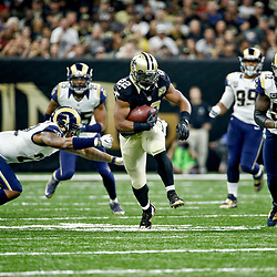 Nov 27, 2016; New Orleans, LA, USA;  New Orleans Saints running back Mark Ingram (22) runs past Los Angeles Rams cornerback Trumaine Johnson (22) during the first half of a game at the Mercedes-Benz Superdome. Mandatory Credit: Derick E. Hingle-USA TODAY Sports