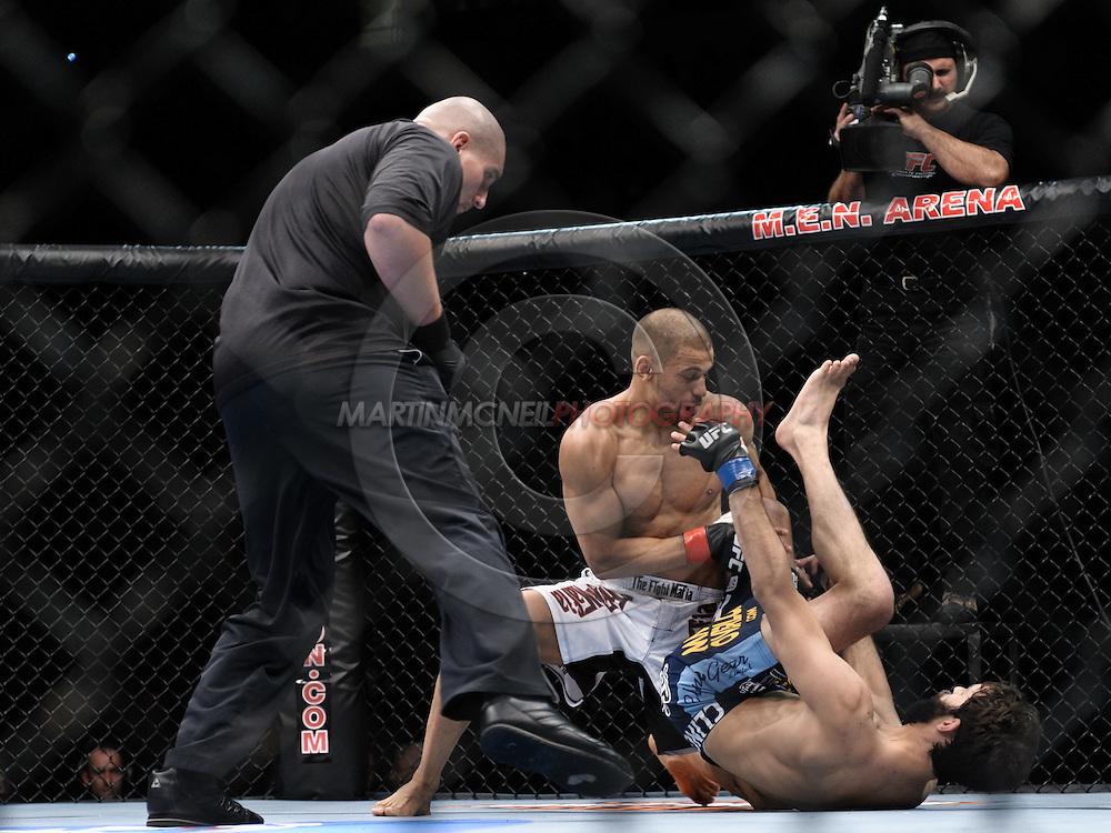 "MANCHESTER, ENGLAND, NOVEMBER 14, 2009: Andre Winner (top) and Rolando Delgado during ""UFC 105: Couture vs. Vera"" inside the MEN Arena in Manchester, United Kingdom."