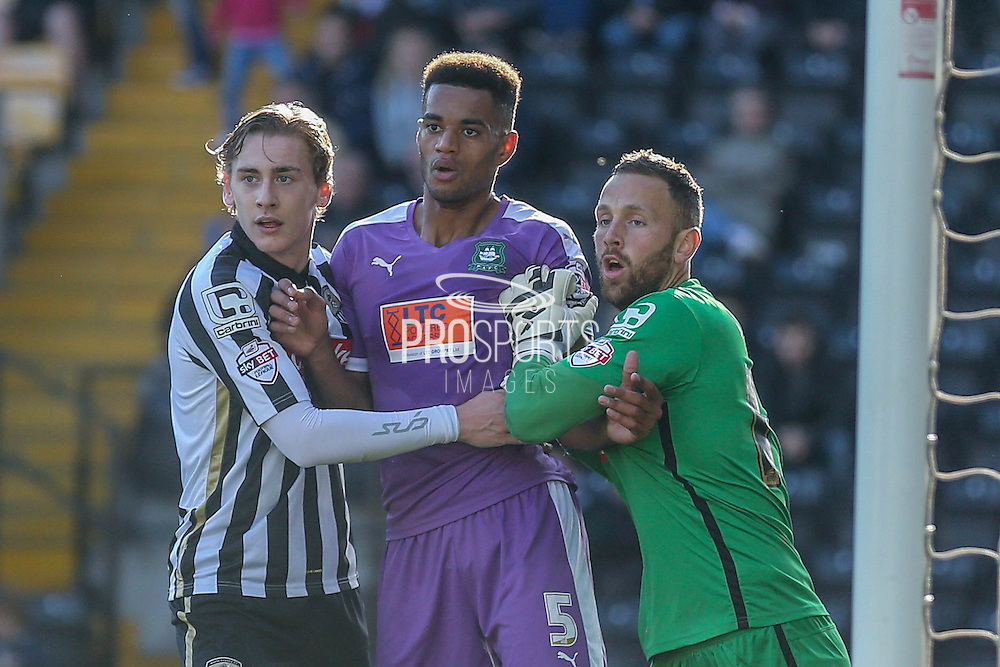 Notts County defender Elliot Hewitt and Notts County goalkeeper Scott Loach keep Plymouth Argyle defender Curtis Nelson  at bay during the Sky Bet League 2 match between Notts County and Plymouth Argyle at Meadow Lane, Nottingham, England on 11 October 2015. Photo by Simon Davies.