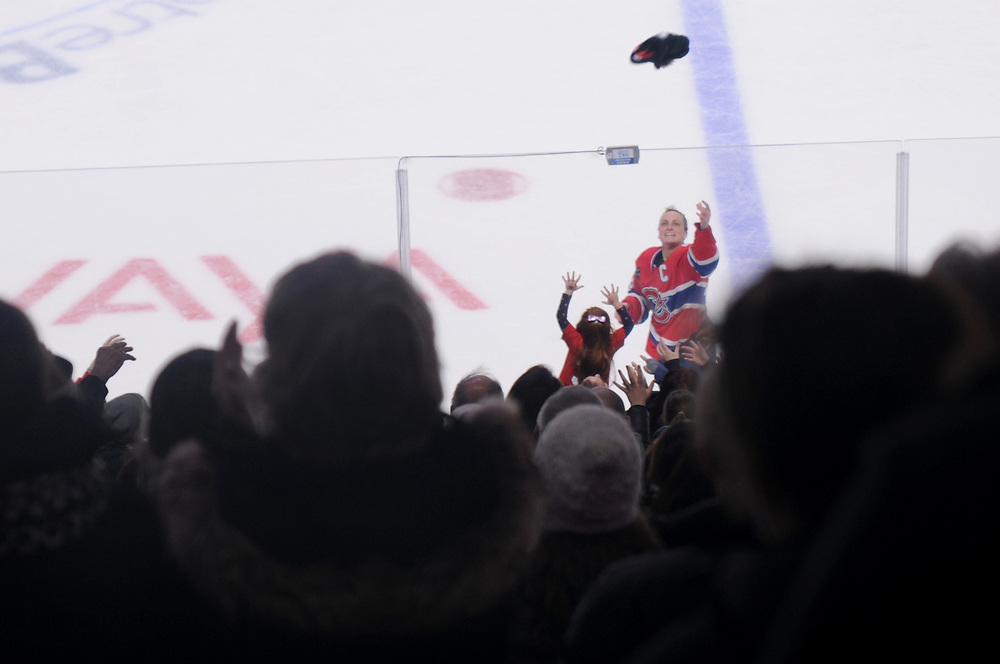 Les Canadiennes foreward Marie Philip Poulin tosses a t shirt into the crowd as she was named the 1st star in a 1-0 victory over the Calgary Inferno at the Bell Centre. It was the 1st ever professional women's hockey game played at the Bell Centre. (Published in Cult MTL. December 2016)