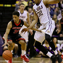 Jan 26, 2016; Baton Rouge, LA, USA; Georgia Bulldogs guard J.J. Frazier (30) is pressured by LSU Tigers forward Craig Victor II (32) during the first half of a game at the Pete Maravich Assembly Center. Mandatory Credit: Derick E. Hingle-USA TODAY Sports
