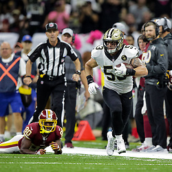 Oct 8, 2018; New Orleans, LA, USA New Orleans Saints linebacker A.J. Klein (53) returns a fumble against the Washington Redskins during the third quarter at the Mercedes-Benz Superdome. The Saints defeated the Redskins 43-19.
